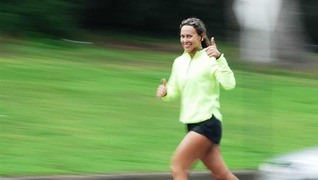 Running Woman in Green Top