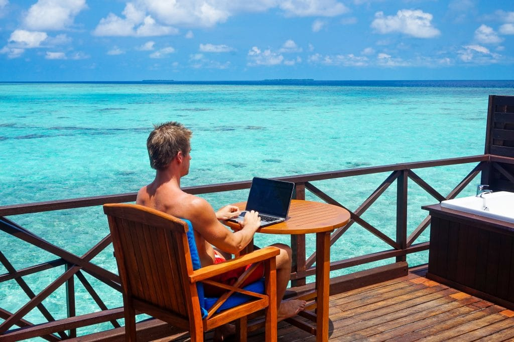 Jacob Cass on Laptop in Maldives