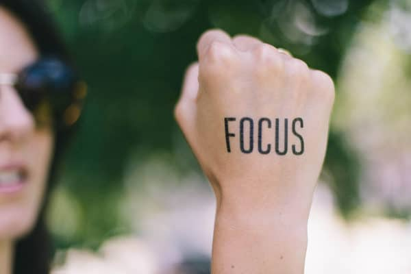 Photo of the word focus written on a hand
