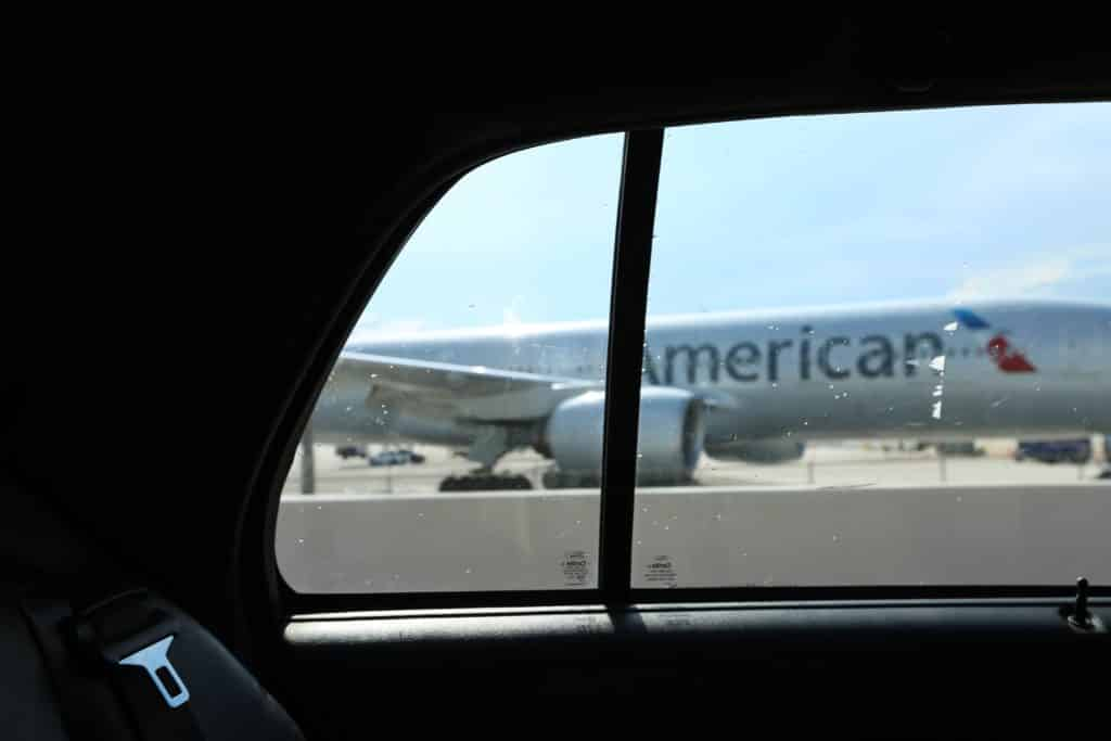 American Airlines plane from inside a car on runway: Branding Mistakes