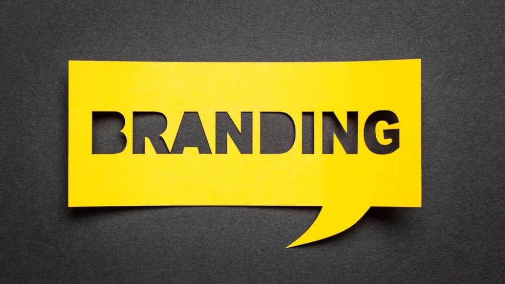 Branding in black letters in yellow cutout - Branding Lessons From Entrepreneurs