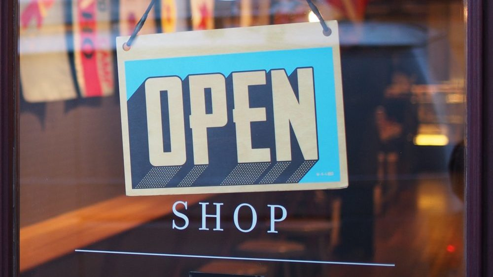 Open shop sign on door - Start your first business with no money