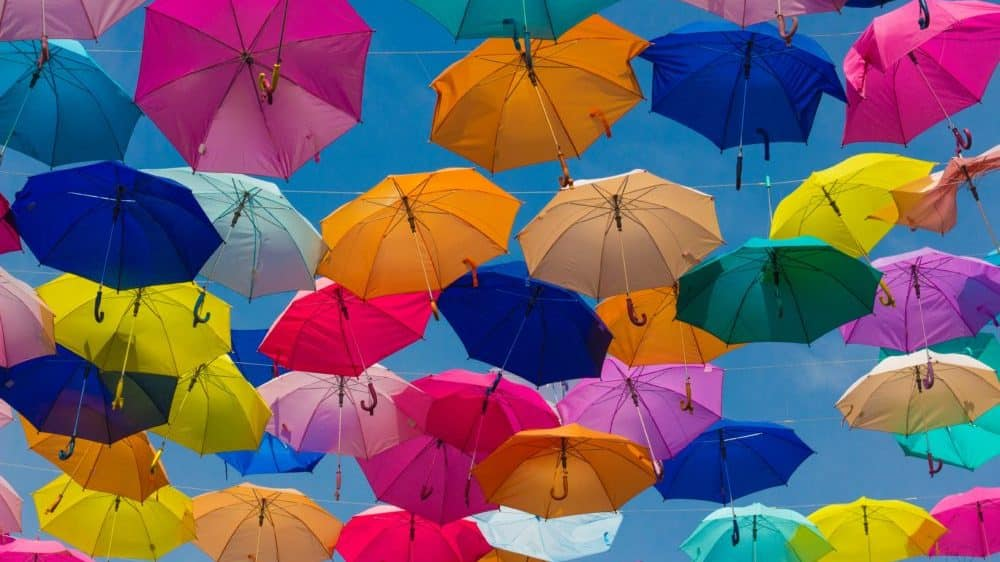 Colourful umbrellas in sky - Insurnace for Startups and Small Business