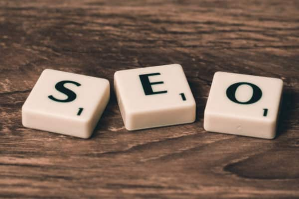 SEO Scrabble tiles on wooden table - How to Rank High for Lucrative Keywords
