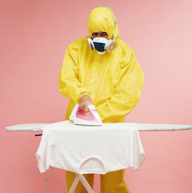 Person in yellow protective suit ironing tshirt - Starting a Business While Quarantined