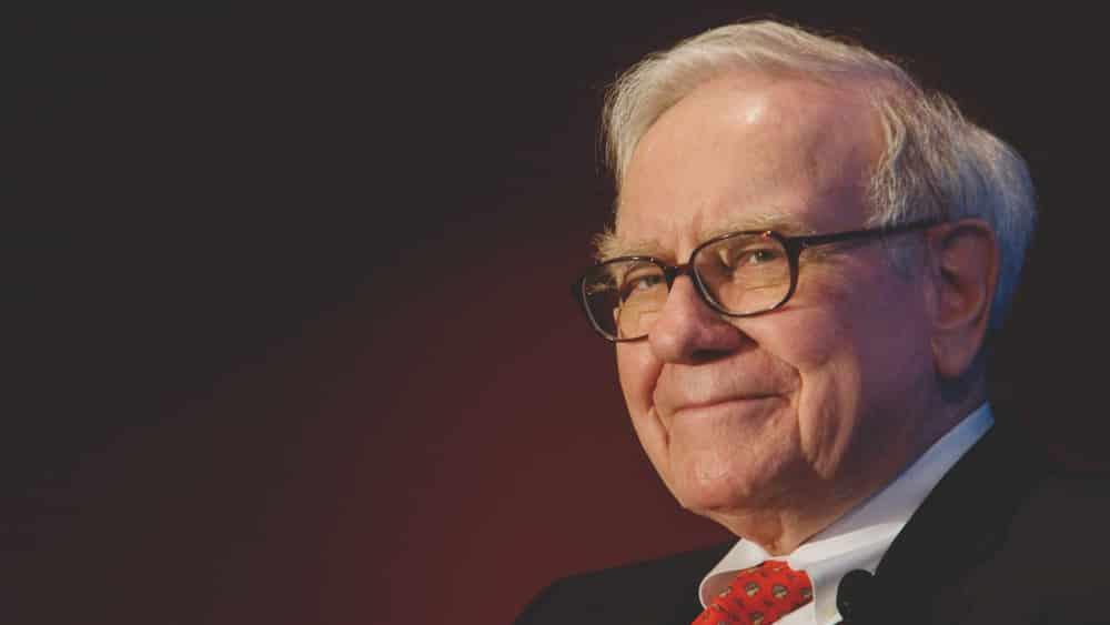 Warren Buffet smiling - 6 Valuable Branding Lessons from Millionaire Entrepreneurs