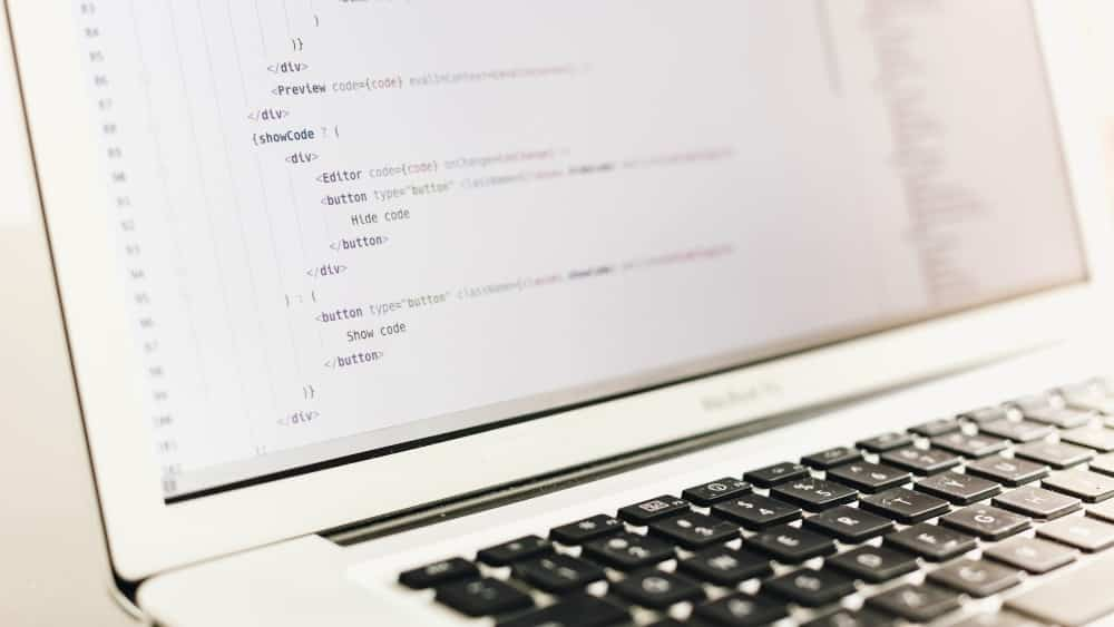 laptop displaying html code including image alt text - 5 Ways To Immediately Improve Your Startup's SEO