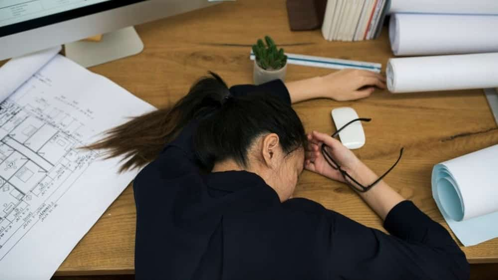 Woman napping at her desk during the day