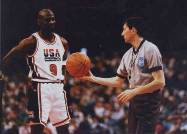 Michael Jordan on court with referee gathering competitive intelligence