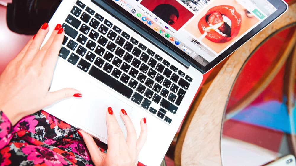 Woman Using Laptop With Remote Working Tools For Marketing Teams