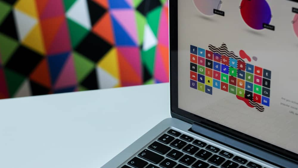 Graphic designer laptop and colourful wallpaper