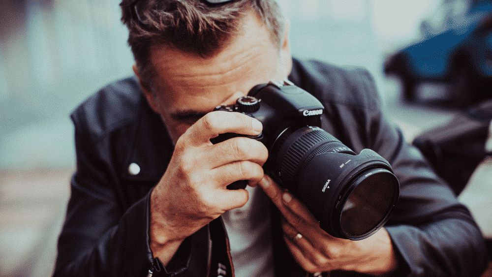 Photographer Taking Photo - How To Improve Your Photography Brand