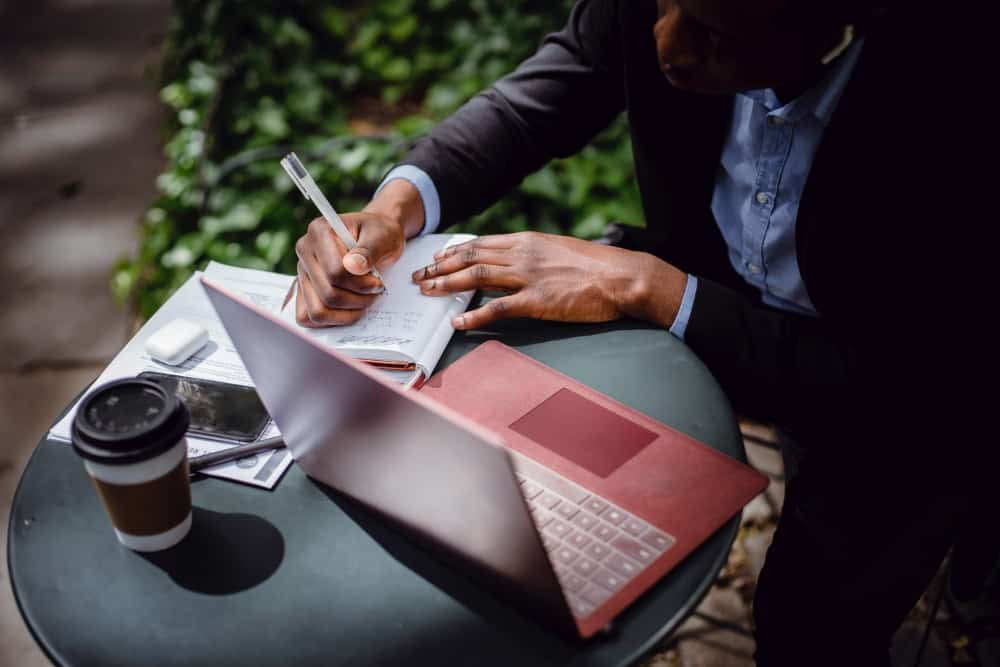 Writing sales copy on notebook and laptop