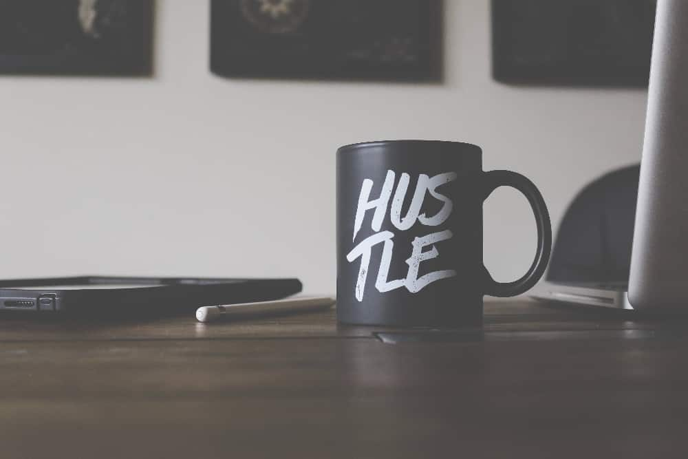 Hustle mug on freelancer's desk