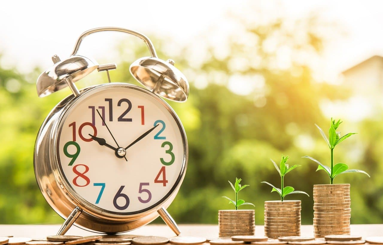 Clock and plants growing larger with more money invested