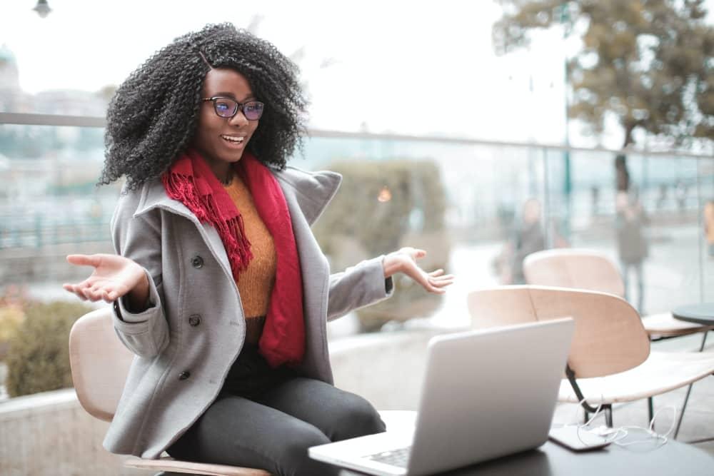 Woman enjoying user experience on website using laptop