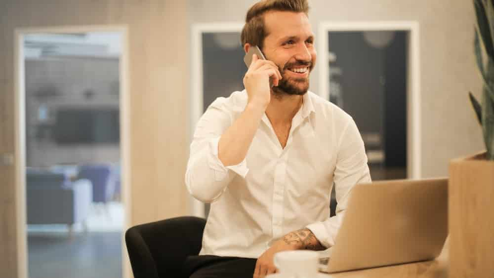 Man on phone following up sales lead