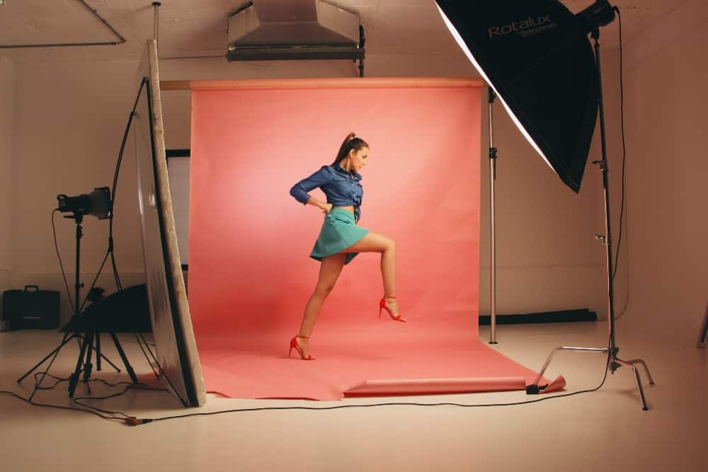 SEO alt text example - photoshoot of woman modelling clothes with lighting